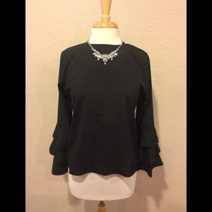 Tops - Black shirt with bell sleeves.